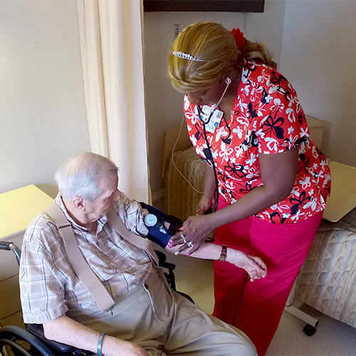 Skilled Nursing Round Pic - Nurse taking patient blood pressure
