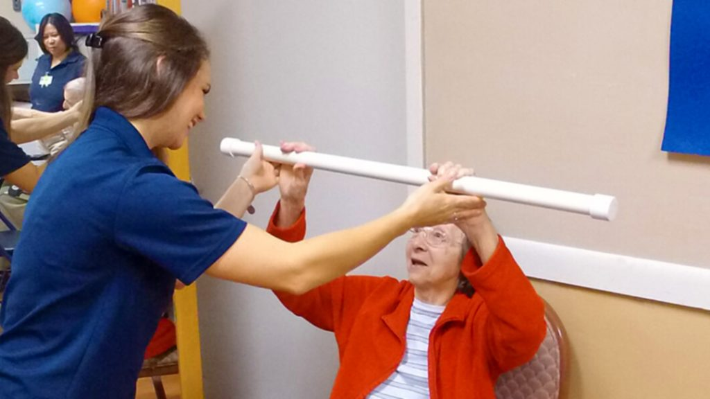 Physical Therapist with Patient Bar Raises